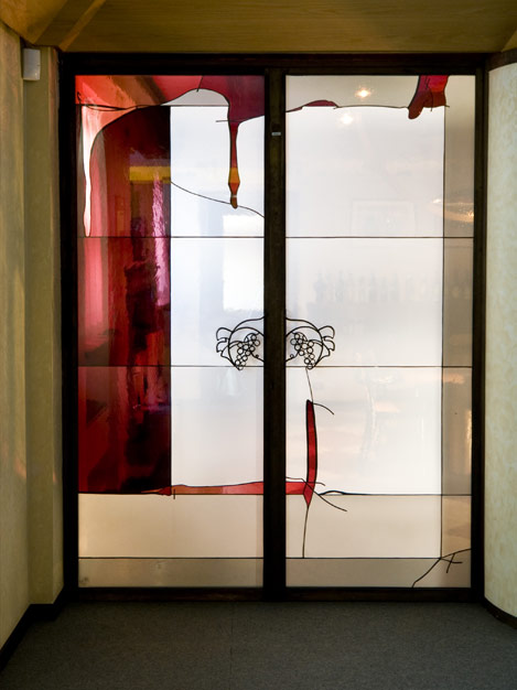 Mouth blown glass doors of the office.
